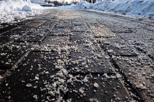 Ice Removal on a sidewalk
